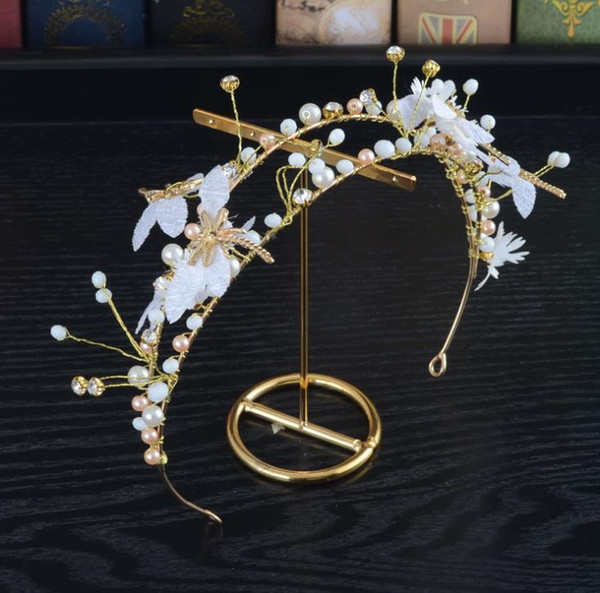 Sweet bridal headwear, lace flowers, dragonfly hoops, handmade beads, butterflies, crown wedding accessories.
