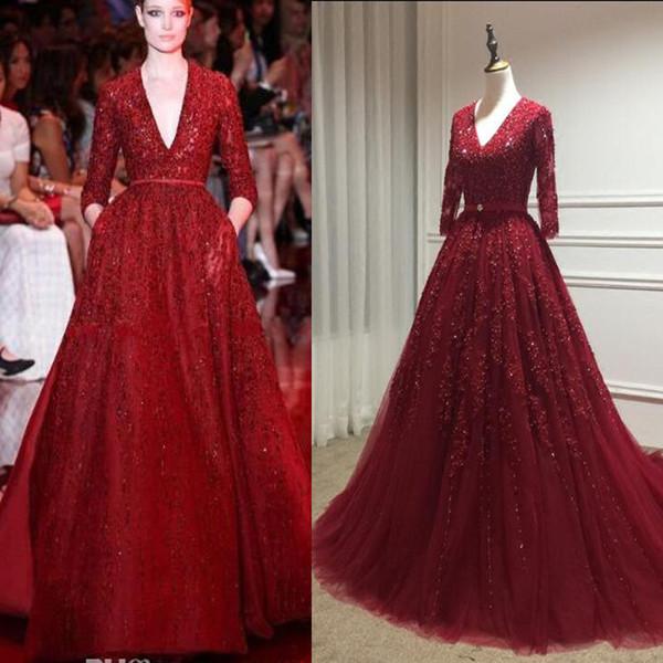 Gorgeous Elie Saab Red Noble vestidos de noche Celebrity Dresses Lentejuelas brillante profundo con cuello en V manga larga manga larga vestido formal