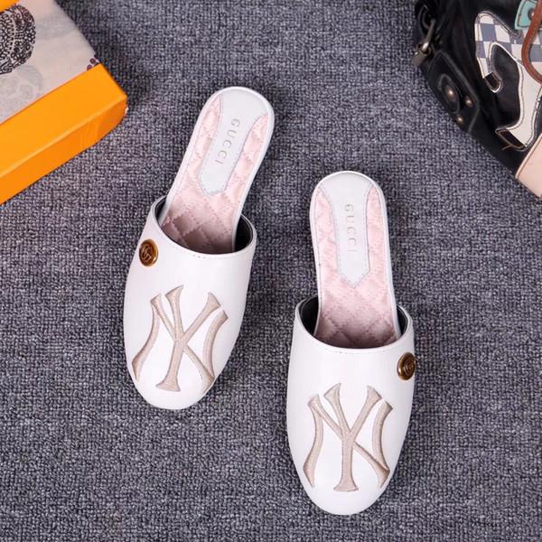 Modelos de explosión zapatos de mujer de comercio exterior 2018 nuevas marcas europeas y americanas grandes bordados de viento rayas Baotou zapatillas planas 1601518