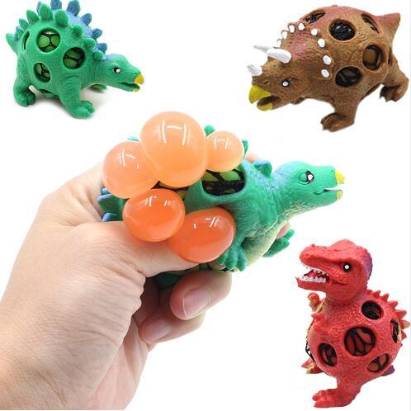 24PCS / LOT enfants pincent nouveauté dinosaure raisin gag jouets exploser perle décompression soulagement balle de raisin Tyrannosaurus blagues pratiques