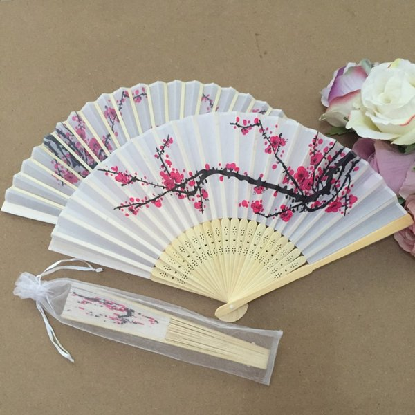 Fans with white organza bags