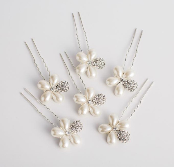 Bridal drill, hairpin, wedding head, hair, head, flower, hair, ornament, and jewelry.