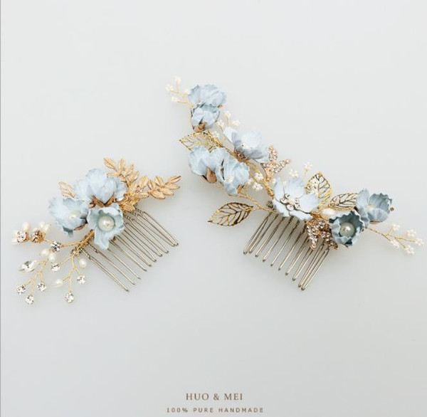 Bridal headwear with blue flowers, hair comb, pearls, U type hair pin, female head, wedding dress, and comb.
