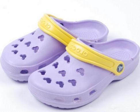 Été nouveau style EVA jardin trou chaussures évider léger massage belles dames anti-dérapant pantoufles fraîches respirantes