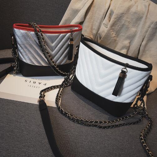 Textura de la PU de la tela, tipo del cubo de la forma del bolso del algodón del poliéster. Equipaje, moda, estilo, bolsa abierta vagabundo, cremallera, elementos populares, cadena r