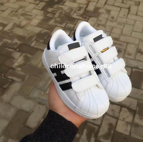 top popular Promotional Hot Sale 2018 classic children's casual shoes new spring boys shoes girls sports shoes size 25-35 17.5cm -22.5cm 2019
