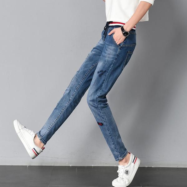 d496624318 Moda clásica 4 temporada pantalones vaqueros de cintura elástica con  cordones mujer pantalones harén bordado lavado