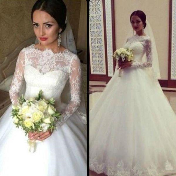 Gorgeous Long Sleeve Ball Gown Wedding Dresses 2019 Illusion Bateau Neckline Lace Top Tulle Skirt Arabic Bridal Gowns Appliqued Hem