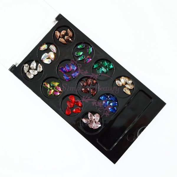 1 Unidades Caja de caja negra 60 UNIDS Colores de mezcla Forma de escudo Pointback Glass Rhinestones Pegamento en 3D Nail Art Manicure Joyería Decoración