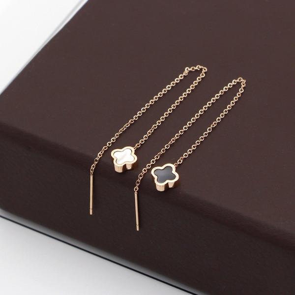 Japanese and Korean black and white double-sided shell mini earrings rose gold earrings female Korean fashion titanium steel earrings