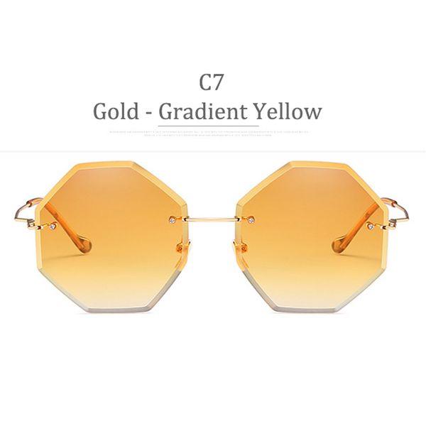 Lenti gialle sfumate con montatura in oro C7