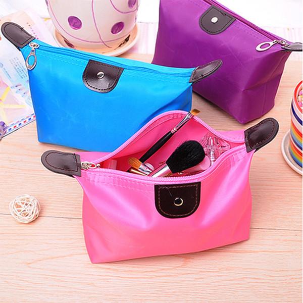 La versione coreana del sacchetto di lavaggio pieghevole impermeabile della borsa delle donne handheld del sacchetto di colore della caramella di gnocco sveglio comercia all'ingrosso
