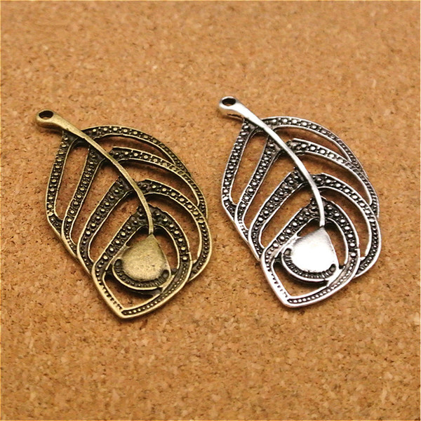 50pcs/lot 49x27MM Handmade Antique Bronze Hollow Tree Leaf Alloy Charms Pendants Diy Jewelry Findings Accessories Wholesale Conversion : 1 inch = 2.54 cm or 1 cm = 0.3937 inch) Category:Jewelery Gender:Women's Occasion:Anniversary, Special Occasion, Party, Gift,Birthday, Engagement, Wedding Jewelry Findings & Components