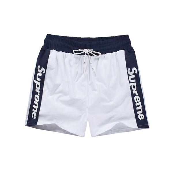 HOT 2019 Pantalones cortos de verano para hombre Pantalones cortos elásticos de 5 vías Bermudas Surf Traje de baño Pantalones cortos de playa de secado rápido