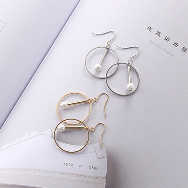 top popular Europe and America minimalist gold and silver round pearl geometric hollow earrings Korean temperament 2019