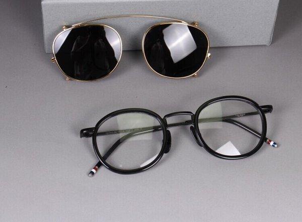 montatura nera con lente grigio oro