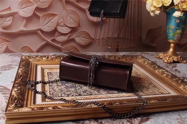 The new luxury handbag counter is made of chocolate, 100% calf leather, deer lining, logo hardware is very special, tassel is more chic!