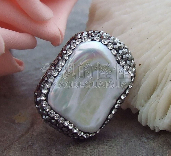 R071012 16x20mm White Keshi Pearl Trimmed With Marcasite Ring