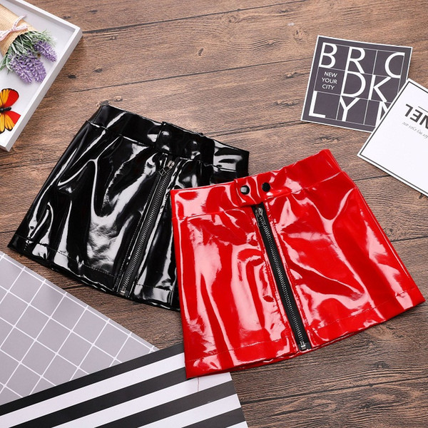 top popular Fashion Girls Leather Zipper Skirts 2018 New Kids Clothes for Boutique Euro America Little Girls Solid Color Leather Short Skirts 2021