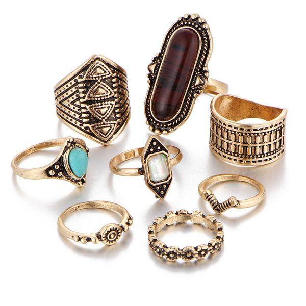 anillo dorado / marrón