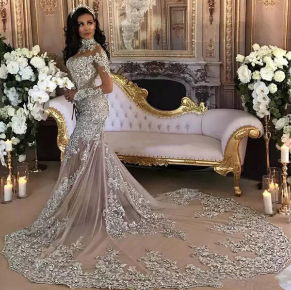 top popular Dubai Arabic Luxury Sparkly 2019 Wedding Dresses Sexy Bling Beaded Lace Applique High Neck Illusion Long Sleeves Mermaid Vintage Bridal Gown 2020