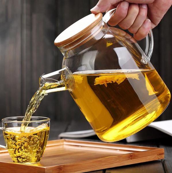 Più nuovo resistente al calore vetro borosilicato teiera bollitore caldo resistente al freddo a doppio uso di bambù teiera per forniture negozio di caffè all'ingrosso