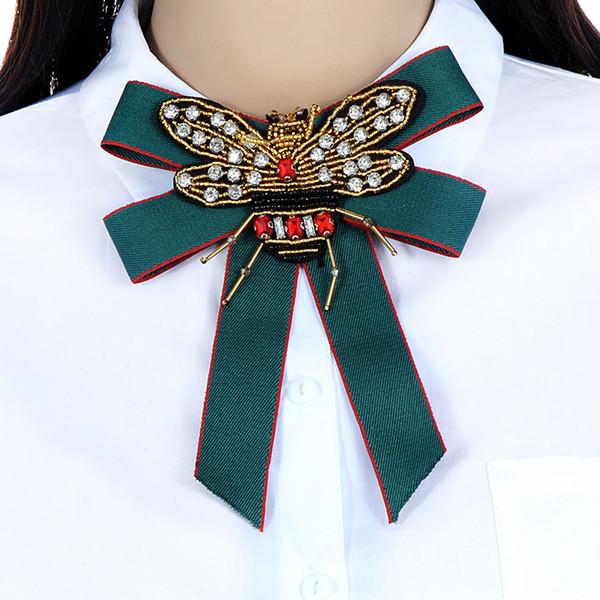 Lujo Royal barroco tela bowknot mujeres broche pin hechos a mano granos de la cinta abeja pajarita broche ramillete vestido camisas joyería