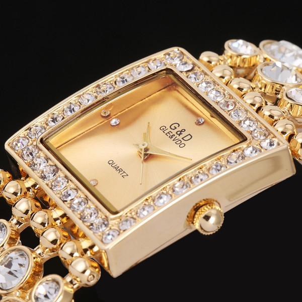 100% echte neue Luxus D Quarzuhr Frauen Stahl Armband Uhr wasserdicht Strass Damen Kleid