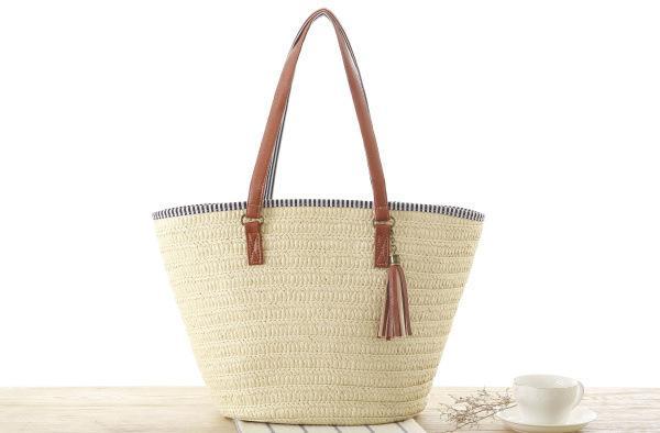 Wholesale 2018 new European and American style simple shoulder woven bag fashion tassel pendant straw bag beach handbag