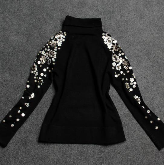 maglione nero a collo alto con bordino maglione imbottito