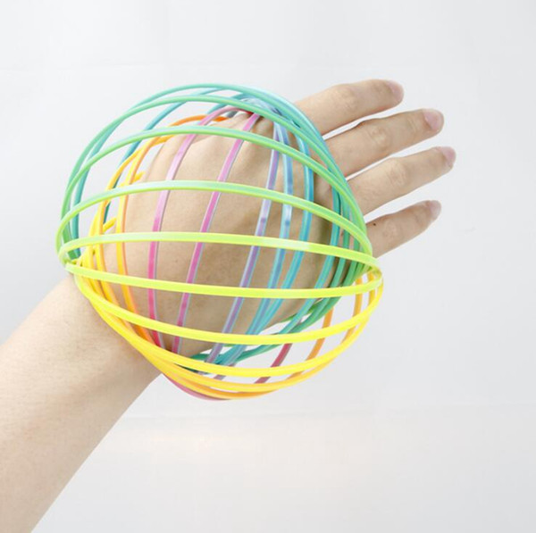 Arcobaleno 3D Anello di flusso del braccio Giocattoli di plastica Toroflux Anello magico giocattoli di decompressione Bambini Regali per bambini 60pcs OOA4745