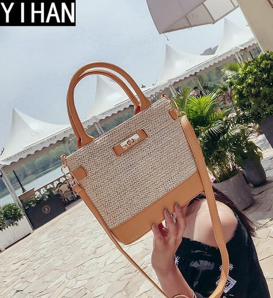 Factory independent brand handbag simple handmade straw beach bag street hit color leather woven hand shoulder bag summer new lock straw bag