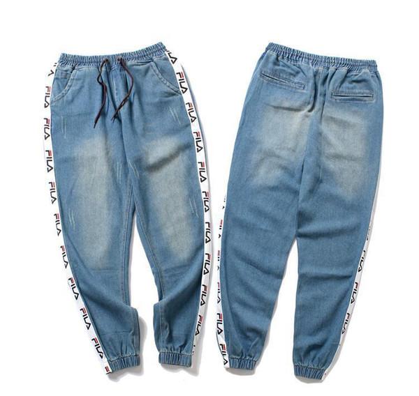 guxi Nuovo 2018 Moda nuovo studente originale designer popolare sciolto jeans di colore chiaro piedi maschili pantaloni harem hip hop Denim pantaloni da cowboy