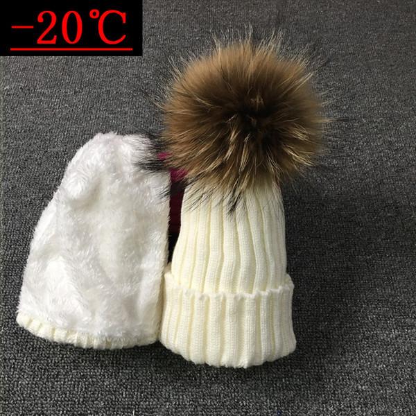 Cappelli di pelliccia di procione reale di alta qualità 100% lana lavorata a maglia Gunuine Fur Pompom Berretti Cappello berretto invernale per le donne