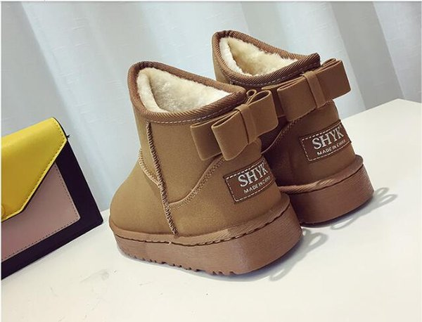 New winter snow boots, sandals, flat-soles, short cylinders, short waterproofing, thickened plush, warm cotton shoes, women's boots.