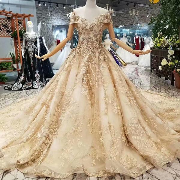 2019 Vestidos de fiesta largos con encaje dorado brillante Fuera del hombro Vestidos de noche de Bling con tren largo Vestido de envío rápido para niña