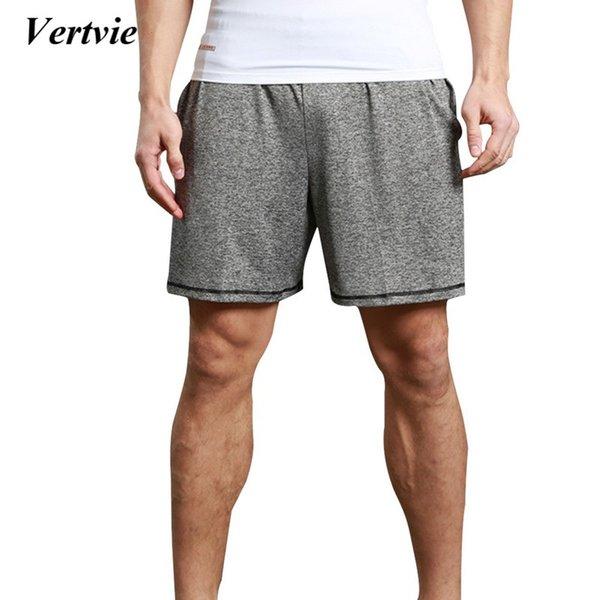 2018 Pantalones cortos sueltos para correr de verano Pantalones cortos masculinos de playa con cordones Boom Solid Hombres Longitud de rodilla Pantalones cortos de baloncesto Sportwear