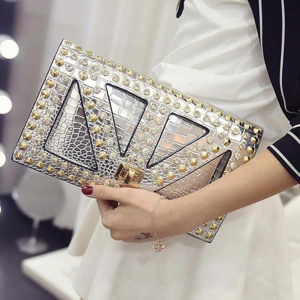 Art- und Weisefrauen-PU-Leder-Kurier bauscht sich neue berühmte Designer-Tageshandtasche schwarze Schädel-spiked Punkart-Umhängetaschen-Tasche Diamanten