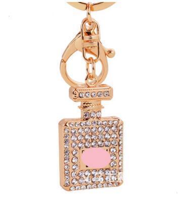 3 colores Diamante de cristal botella de perfume llavero mosquetón llavero anillos titulares bolso cuelga mujeres llaveros llavero de cristal 30 unids