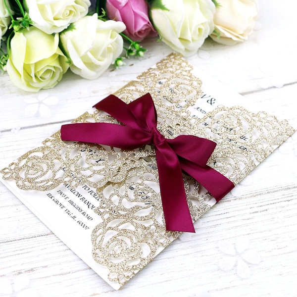 top popular Hot Sale Gold Glitter Laser Cut Invitation Cards With Burgundy Ribbons For Wedding Bridal Shower Engagement Birthday Graduation 2020