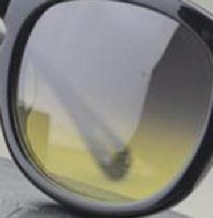 Серый желтый объектив