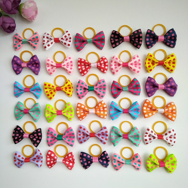 100pcs Dot style Dog Hair Bows Topknot Solid Small Bowknot with Rubber Bands Pet Grooming Products Pet Hair Bows Dog Hair Accessories