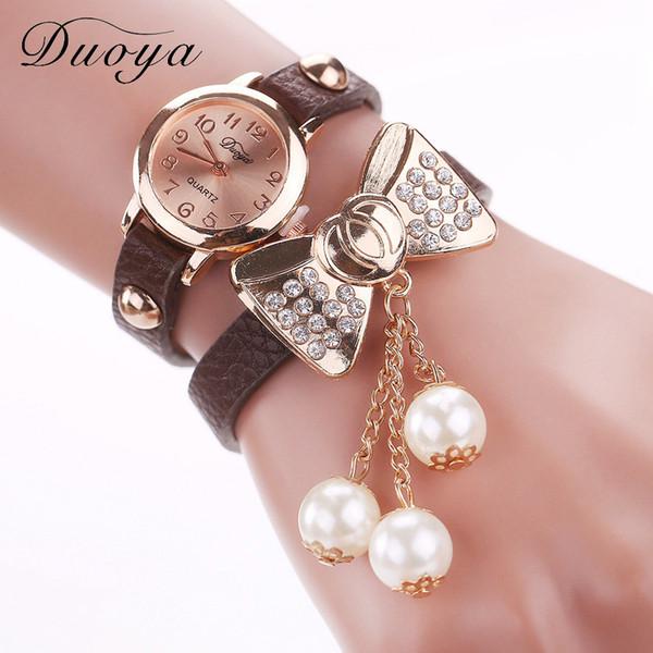 Duoya Femmes Mode Rhinestone Bow Faux Pearl Bracelet Watches Women Fashion Casual Analog Quartz Wrist Watch Ladies Female Clock