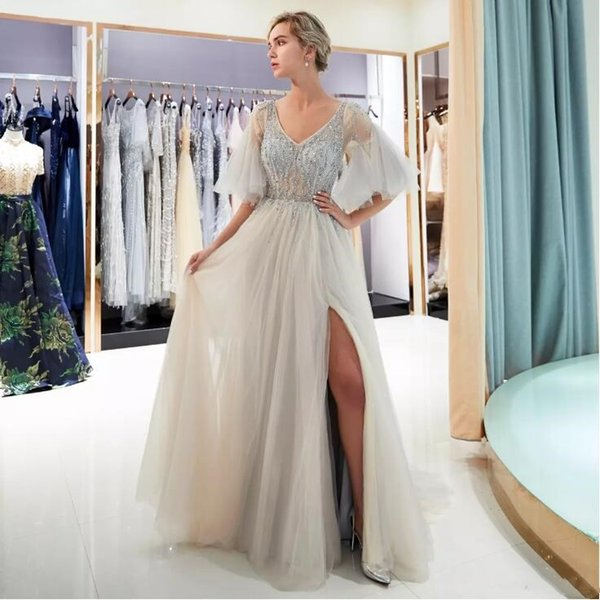 2018 Evening Dresses Party Gray Half Sleeves Beaded Bodice Transparent Champagne High Split A-line crystal Deep V-neckline Dubai Prom Gowns