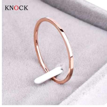 Knock (1.2 MM) Promoción Titanium Steel Rose Gold Color Anti-allergy Smooth Couple Wedding Ring Mujer Hombre Joyería de moda