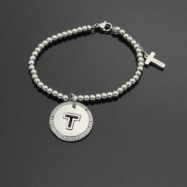 Gros commerce titane acier bracelet vente T lettre ronde licence perles bracelet en or 18 carats coréen T bracelet