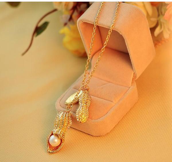 12pcs / lot vendita calda donne belle d'oro colore arachidi squisita collana lunga ciondolo ornamenti di moda perla pisello baccello maglione catena