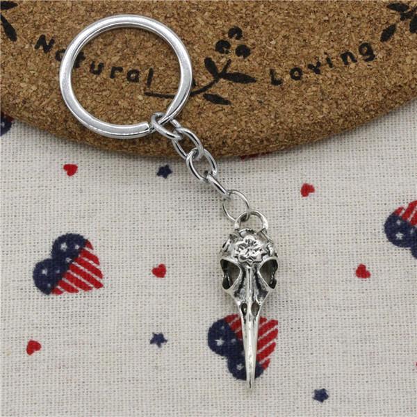 28pcs Fashion Diameter 30mm Metal Key Ring Key Chain Jewelry Antique Silver Plated skeleton bird dagger 41*12mm Pendant