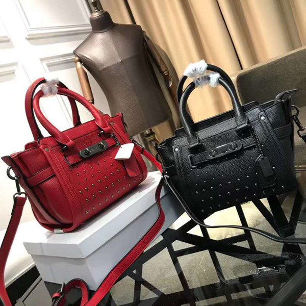 Simple and versatile lady fashion handbag leather solid color European and American style rivet decoration high quality handbag