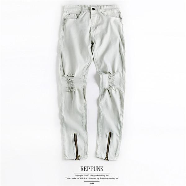 Jeans da uomo estivi progettati Jeans strappati bianchi Pantaloni da joker estivo Pantaloni con cerniera Jeans da strada